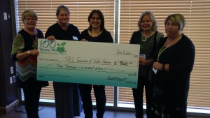 Members of the 100 Women organizing committee presenting the big cheque to the PEI Federation of Foster Families Inc.